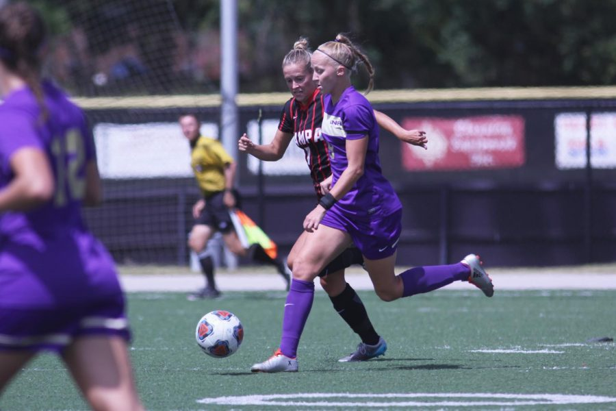 Senior midfielder Stacey Webber attempts to break away from a defender against Tampa Sept. 11. The Lions fell to 1-3 on the season after a 2-1 loss to the Spartans.