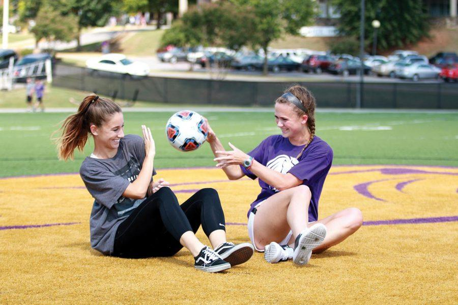 Redshirt freshman Audrey Tanner (left) and sophomore Paige Porter toss a ball around before practice Sept. 16. The duo came to UNA after successful high school careers at Harrison High School in Kennesaw, Georgia.