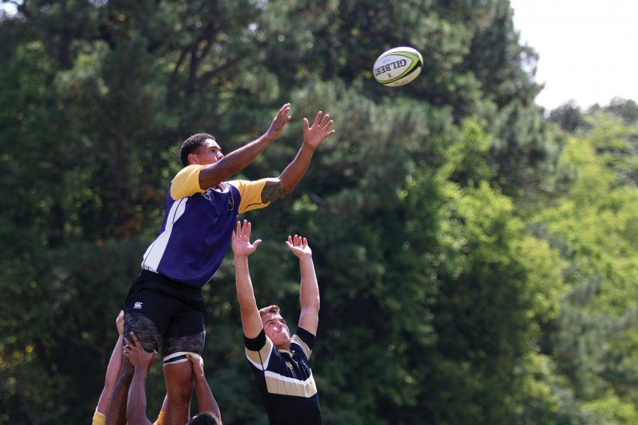Junior Vick Gilbert reaches over a Vanderbilt player in a line-out. UNA won the Sept. 3 game against the Commodores, 20-0 at Veterans Park.