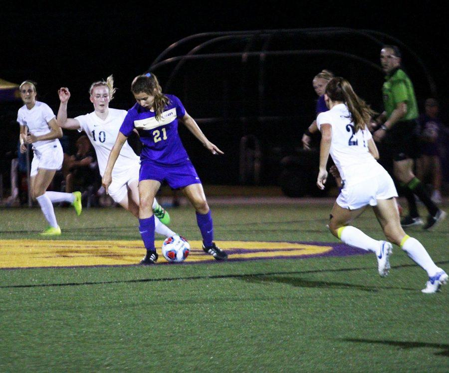 Sophomore midfielder Margarida Sousa dribbles around a defender against Nova Southeastern Sept. 9 during the Lion Shootout tournament nightcap. Tied 1-1 in overtime, Sousa scored the winning goal in the 108th minute to give UNA its first win of the year.