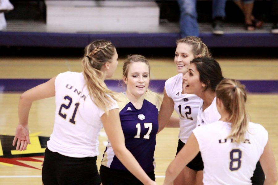 UNA+volleyball+players+celebrate+a+momentum-building+point+against+West+Alabama+Sept.+13+in+Flowers+Hall.+The+Lions+opened+Gulf+South+Conference+play+with+a+victory%2C+improving+to+9-0+overall.