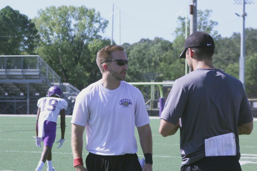 UNA running backs coach Courtland Hays looks for a signal during practice Sept. 20. Hays began his football career as an equipment manager for UNA in 2007 and is now the running backs coach.