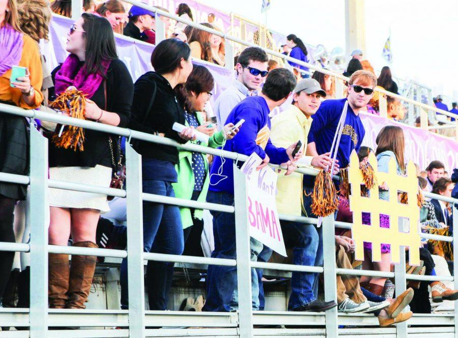 The UNA student section cheers on the Lions during a homecoming game against Western Oregon Oct. 4, 2014. Students must abide by rules pertaining to alcohol consumption and music selection, among others, while tailgating.