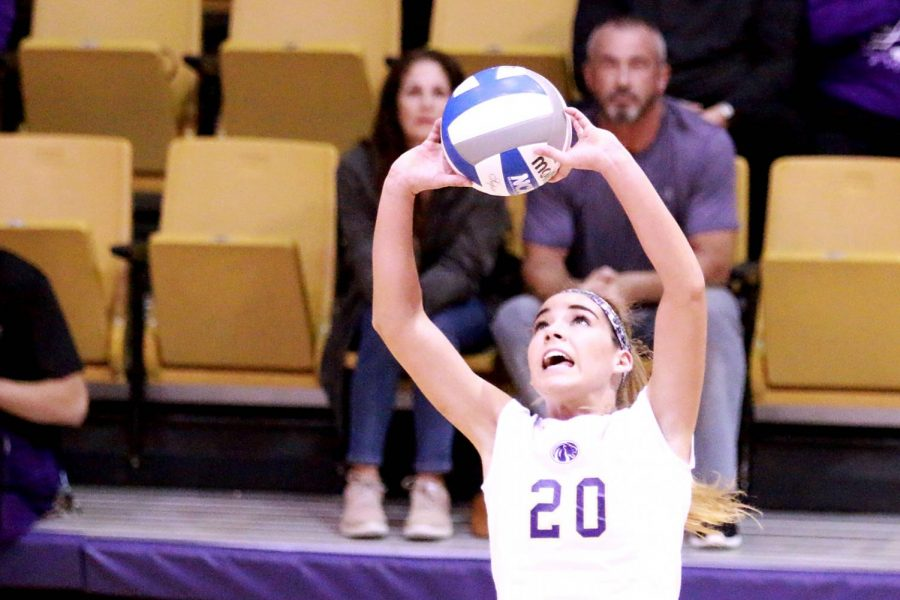 UNA sophomore setter Jayden Davila-McClary lobs up an assist in the match versus the Lee Flames Oct. 21 at Flowers Hall. Davila-McClary placed the Lions in scoring opportunities frequently through the night with 36 assists.