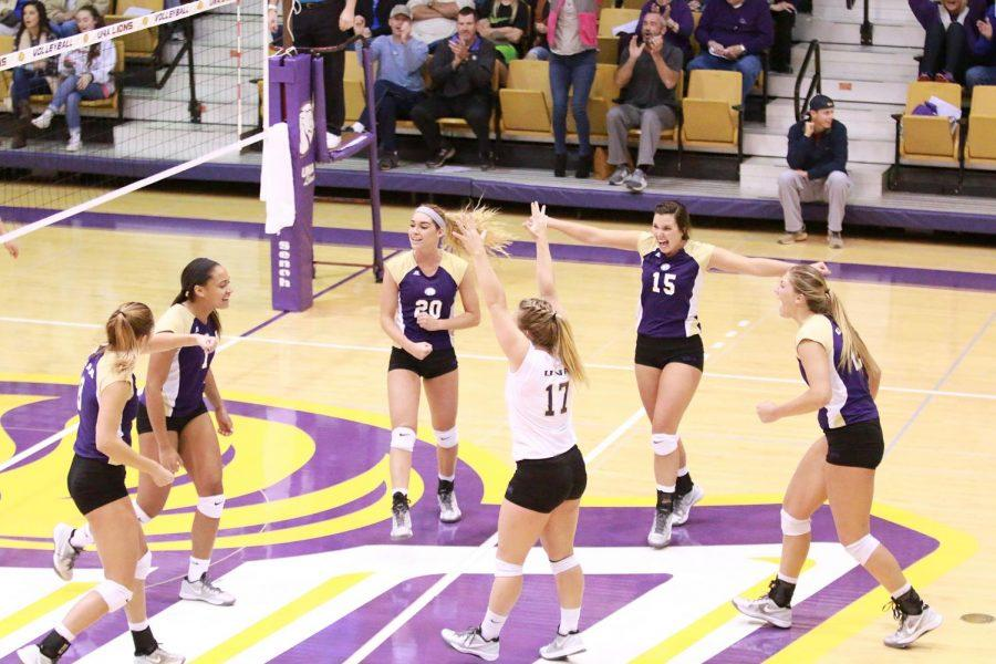 UNA+volleyball+celebrates+a+kill+against+Shorter+in+their+Oct.+22+showdown+in+Flowers+Hall.+The+Lions+have+lived+up+to+their+lofty+expectations+set+in+the+preseason.+They+were+projected+as+second+in+the+Gulf+South+Conference+preseason+poll%2C+which+is+where+they+currently+sit.
