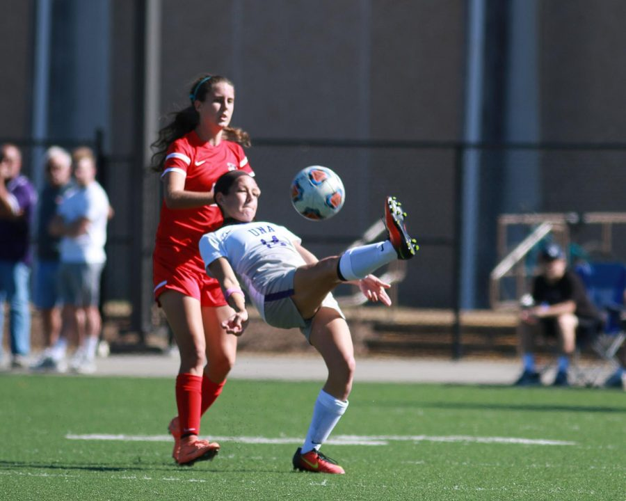 Senior Alyssa Bova (14 white) prepares to bicycle kick against Valdosta State Oct. 23 in Florence. The Lions put on a dominant performance en route to a 5-0 victory on senior day.
