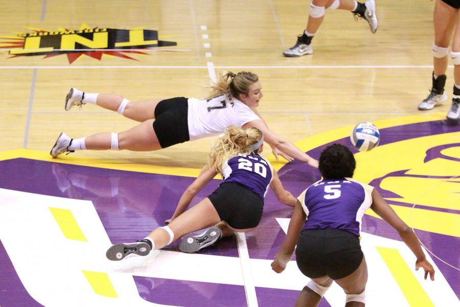 Junior libero Ashtyn Kapovich (17) and sophomore setter Jayden Davila-McClary (20) dive for the ball in the Lions game versus Shorter Oct. 22. UNA won the match 3-1 after previously falling to Shorter on the road 3-2 Sept. 16.