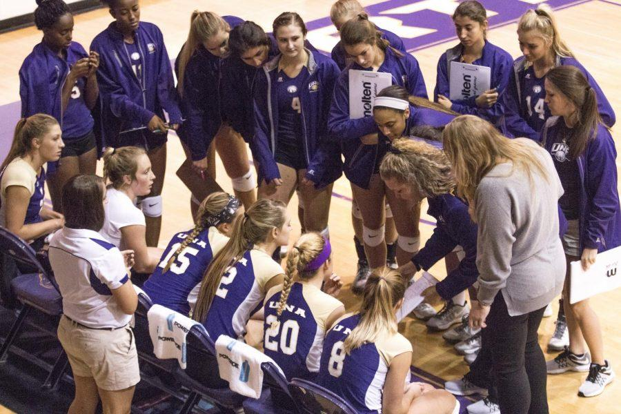 The+UNA+volleyball+team+huddles+around+assistant+coach+Jennifer+McCall+at+Flowers+Hall.+The+Lions+now+have+14+sweeps+on+the+season.