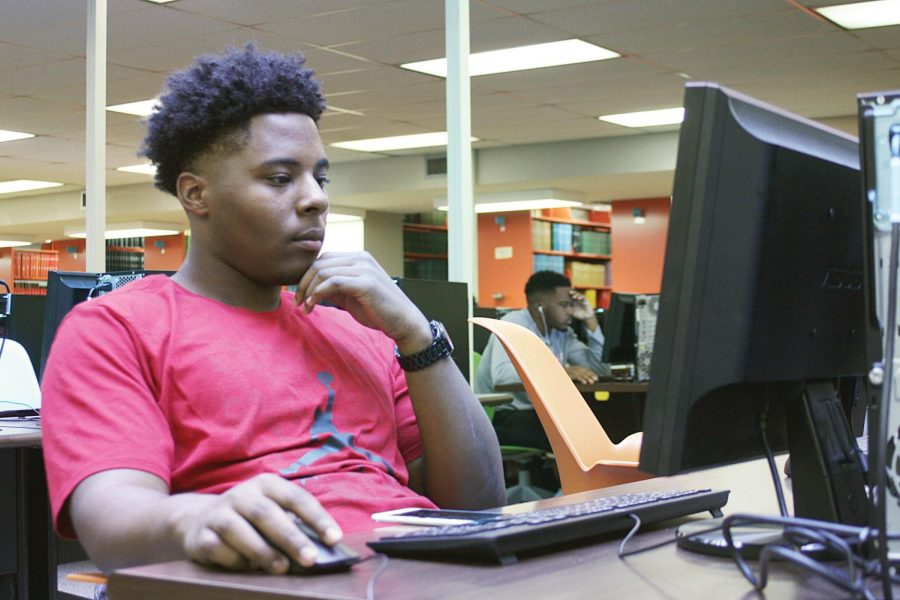 Sophomore Trey Avery works on an assignment for class. Students are more successful when they utilize digital resources, said Director of the First-Year Experience Program Matthew Little.