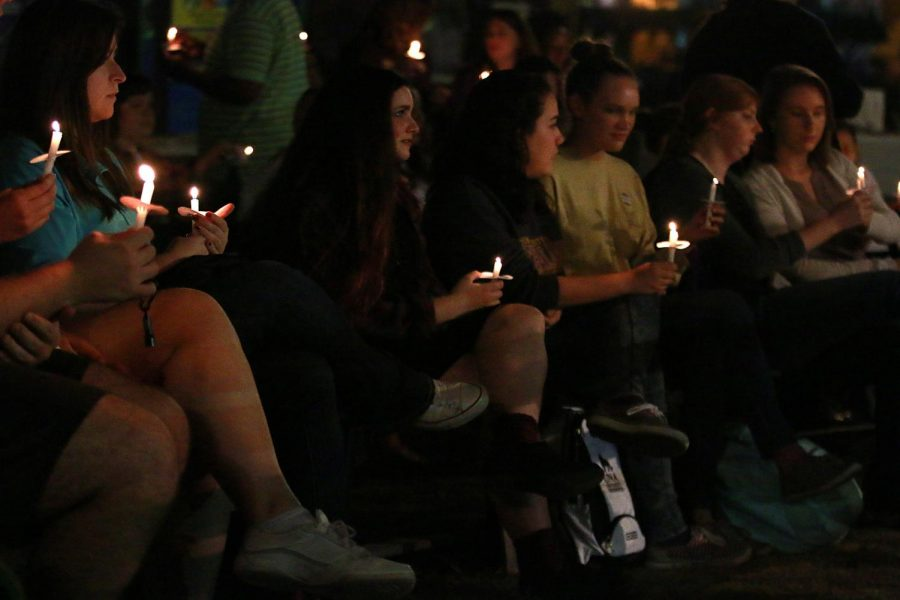 Attendants+hold+their+candles+during+the+candlelight+vigil+at+Take+Back+the+Night.%C2%A0It+was+really+powerful%2C+said+freshman+Shelby+Sisk.+I+think+it+was+really+important+for+all+of+us+to+get+together+and+have+this+meeting.