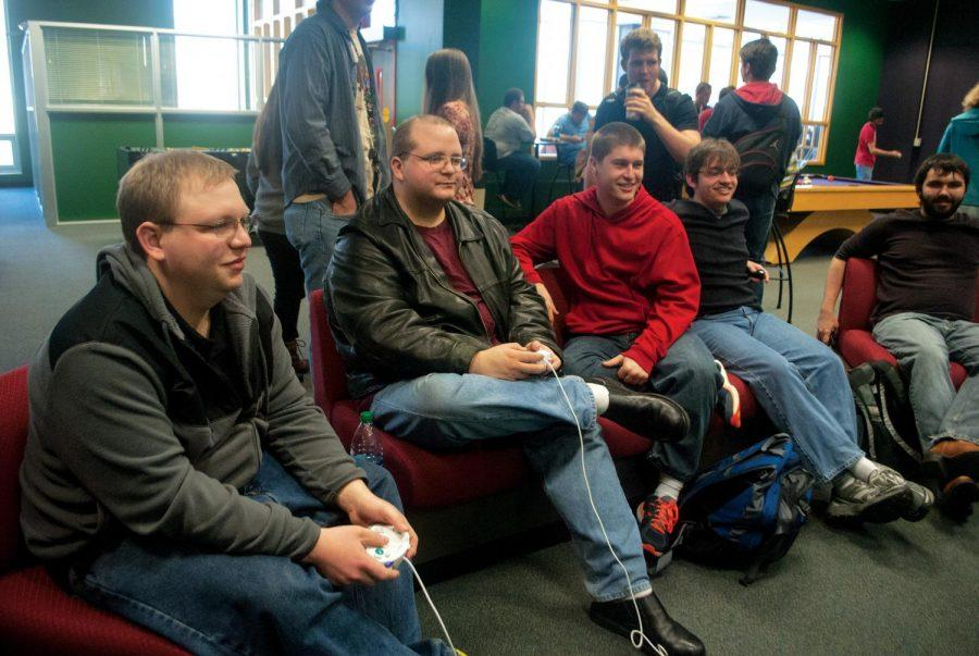 """Students compete against each other in the Lion's Den Game Room. """"At the beginning of the semester, students start asking (for the tournaments),"""" said Gigi Broadway, senior administrative assistant of University Events."""
