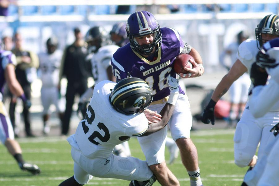 Senior+All-Gulf+South+Conference+quarterback+Jacob+Tucker+runs+through+a+North+Carolina-Pembroke+defender+during+their+NCAA+Division-II+second+round+playoff+meeting+Nov.+26+in+Florence.+North+Alabama+handily+defeated+the+Braves+41-17+to+advance+to+the+third+round+of+the+playoffs+with+the+win.