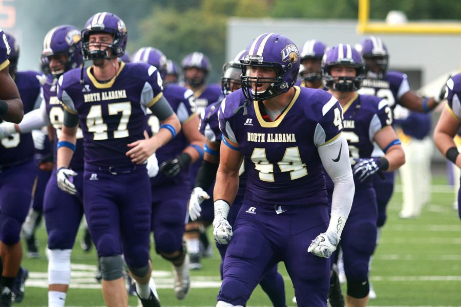 Senior linebacker Barron Miller (44) leads the team out onto the field for UNA's home opener vs. Valdosta State Sept. 17. Miller, along with a number of other seniors, will take the field at Braly Stadium for the final regular season home game against West Florida Nov. 5 for senior day.