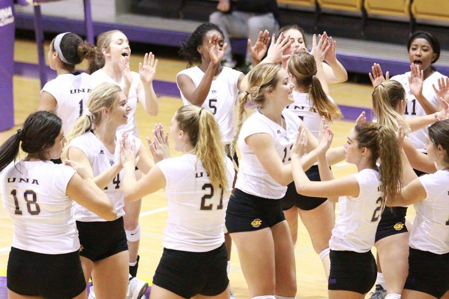 The North Alabama volleyball team celebrating before a match against Valdosta State Nov. 12. The Lions won their second straight Gulf South Conference tournament title Nov. 20 in a 3-2 nail-biter at West Florida.