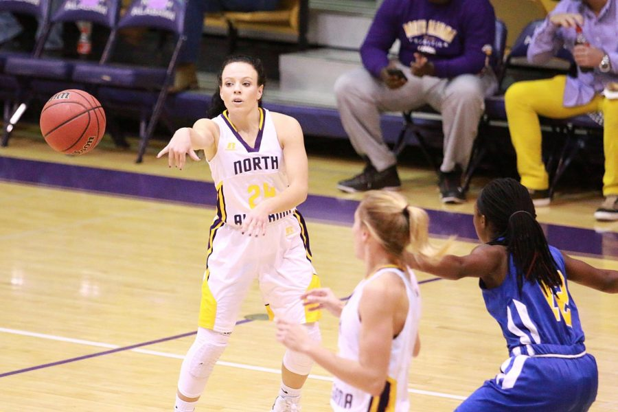 Junior guard Jaclyn Heath passes the ball to a teammate in North Alabama's home opener against Oakwood Nov. 17. The Lions improve to 3-0 on the season and UNA head coach Missy Tiber improves to 4-1 in home openers in her UNA career.