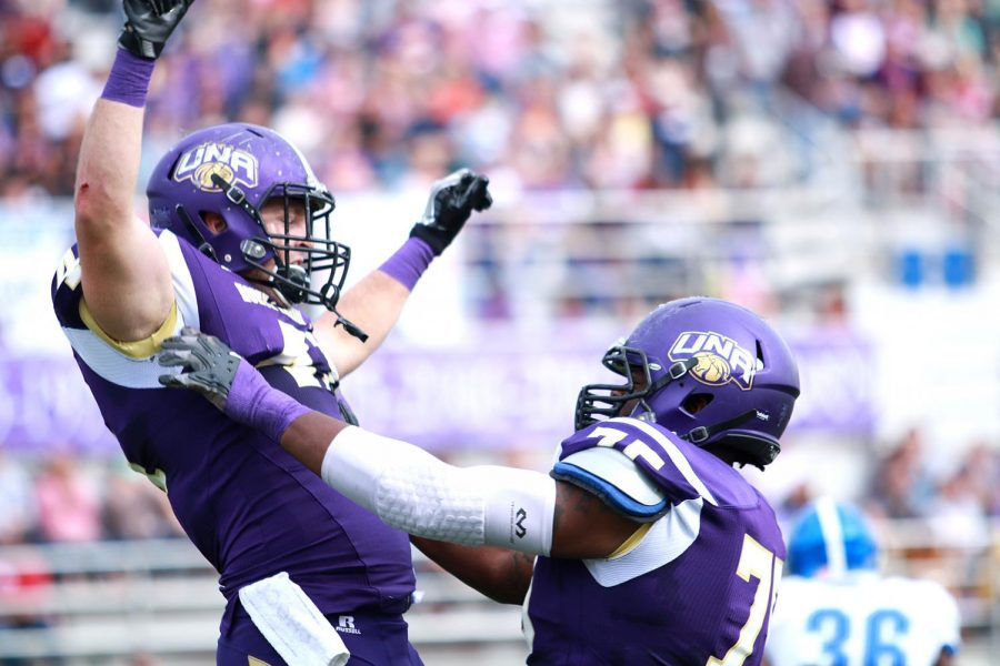 North Alabama football players celebrate during their 51-3 victory over West Florida Nov. 5 at Braly Stadium. The Lions currently sit atop the region rankings after winning a fourth straight Gulf South Conference title.