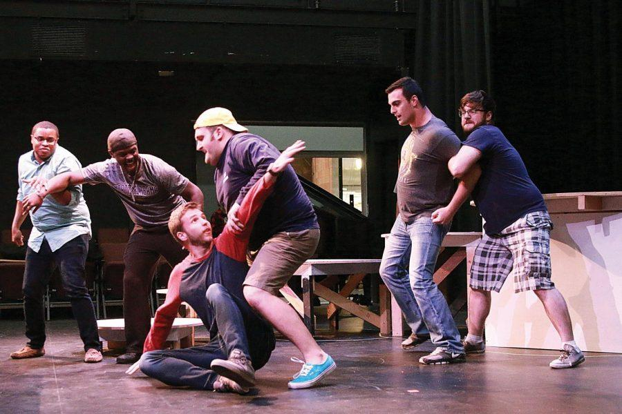 """Part of the cast of """"Romeo et Juliette"""" practices a fight scene for the performance. """"As a concept, I wanted to make things modern, so costuming is close to what we wear today, and I traded in swords for knives,"""" said Tiffany Bostic-Brown, stage director of UNA Opera and Musical Theatre."""