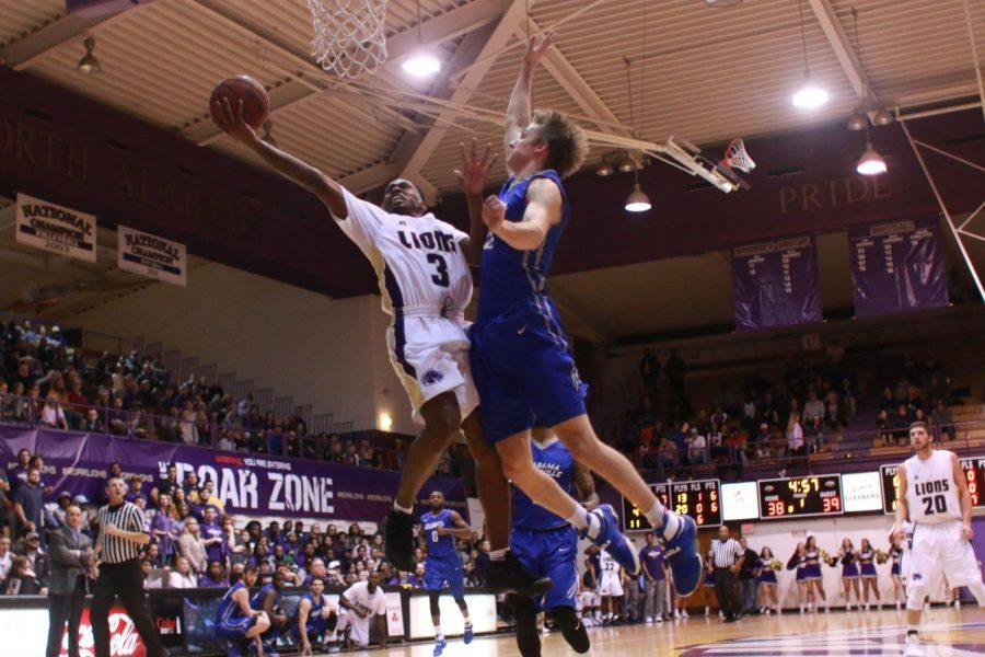 Junior guard Jeff Hodge Jr. goes up for a layup in North Alabama's game against Alabama-Huntsville. The Lions let a 50-50 first half tie slip away in the second where they fell 91-79 at Flowers Hall.