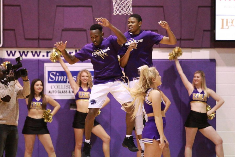 Junior guard Jeff Hodge Jr. (left) and senior guard DeAndre McKinnie celebrate before North Alabama's home game against Alabama-Huntsville Dec. 4. The Lions rebounded after the loss to the Chargers to come away with a dominant victory versus Huntingdon Dec. 10 at Flowers Hall.