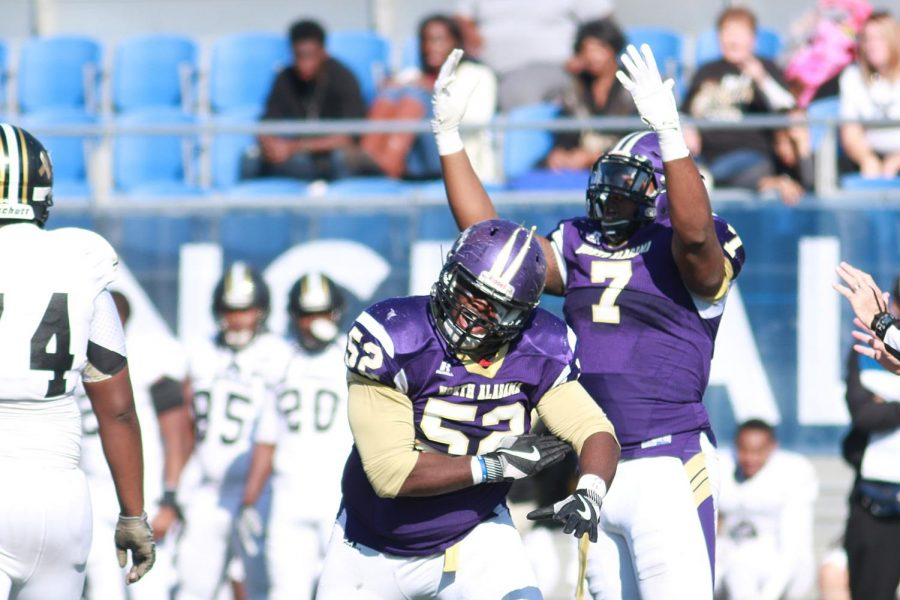 North+Alabama+defenders+Sheldon+Lewis+%2852%29+and+E.J.+Parnell+celebrate+a+stop+in+the+Lions%27+second+round+showdown+against+North+Carolina-Pembroke+Nov.+26+in+Florence.+UNA+went+on+the+road+to+face+Shepherd+in+the+semifinals+and+defeated+the+Rams+23-13+to+earn+a+spot+in+the+Division+II+national+championship+game+for+the+first+time+since+1995.%C2%A0