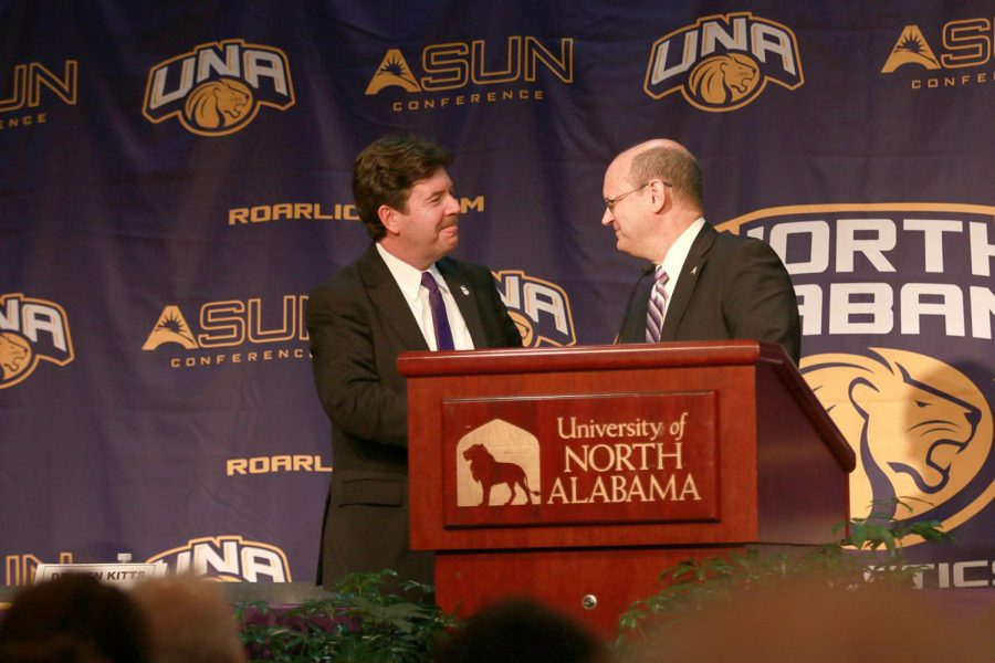 University President Kenneth Kitts (left) and Atlantic Sun Conference Commissioner Ted Gumbart shake hands to confirm UNA's partnership with the ASUN Dec. 6 in the Guillot University Center. The Lions will participate in Division I athletics starting in fall 2018.