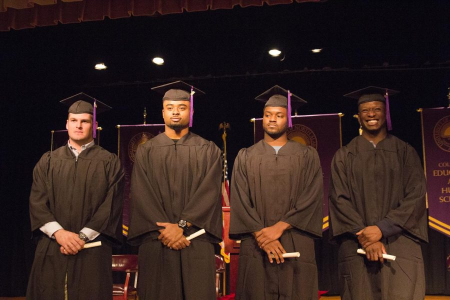 North Alabama football players (L-R) Ryan Harper, Khyle Jackson, James Rivers and Josh Tate posing after their graduation ceremony Dec. 13 at the Guillot University Center. The student-athletes will miss the originally scheduled commencement Dec. 17 as they face Northwest Missouri State in the national championship game at Kansas City, Kansas.
