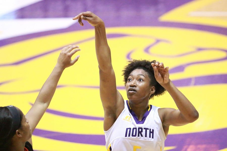 Junior guard KeKe Gunter attempts a long-range shot in North Alabama's game against Auburn-Montgomery Nov. 29 at Flowers Hall. The Lions are now 6-0 entering Gulf South Conference play.