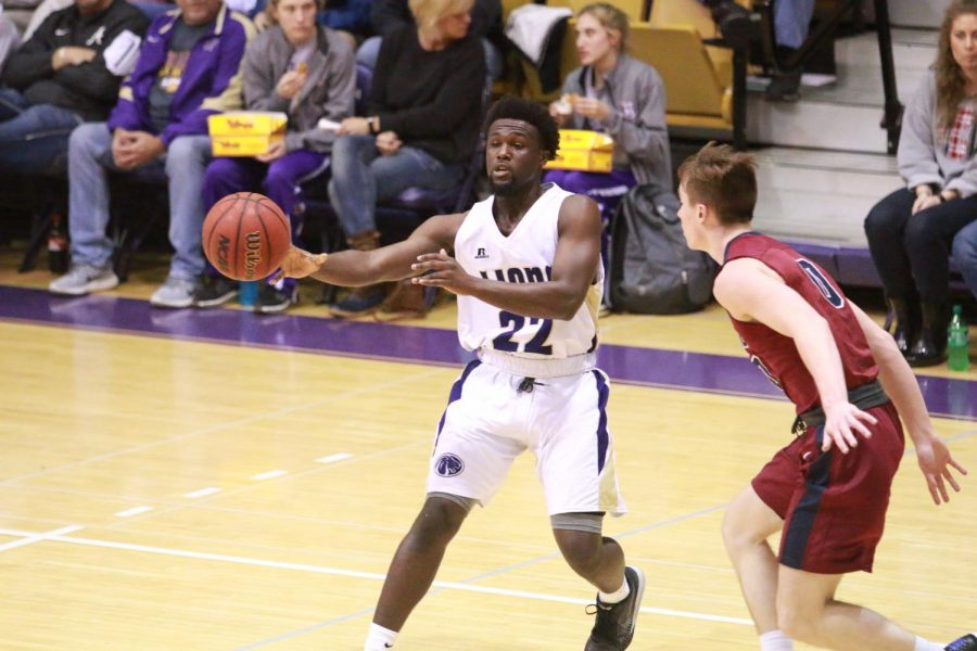 North Alabama sophomore guard Tavaras Tolliver passes the ball on the perimeter in the Lion's home game against Lee Jan. 19. The Lions dominated in the paint, out rebounding the Flames 45-21 in the 83-66 victory.