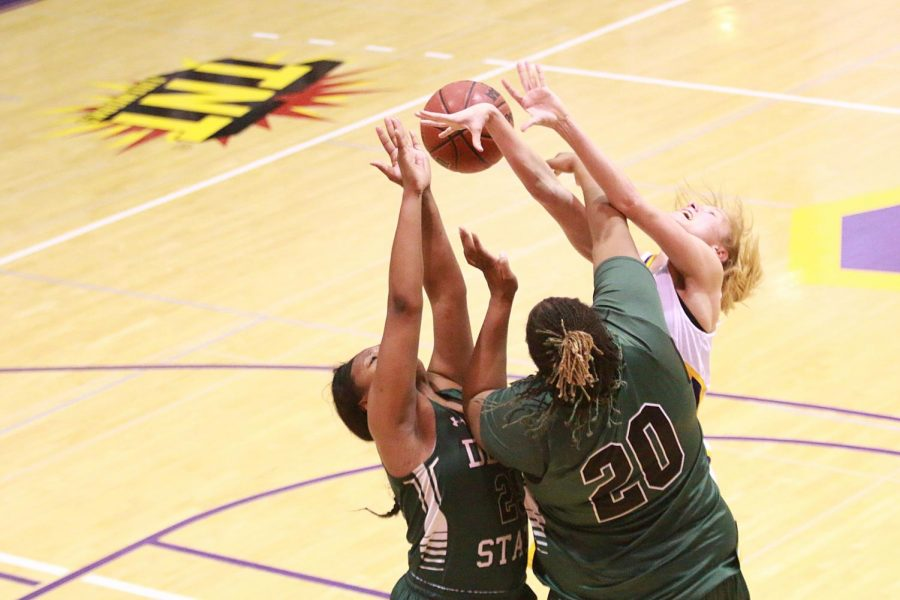 North Alabama guard Ivy Wallen draws a foul as she drives to the basket against Delta State Jan. 28 at Flowers Hall. After scoring 57 points in the first half in its previous game versus Mississippi College, UNA failed to score that much the whole game versus the Statesmen as they dropped their first home game, 55-52.
