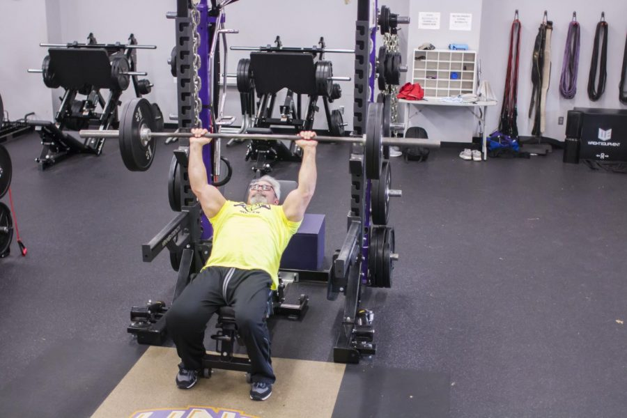 UNA strength and conditioning coordinator Steve Herring exhibits proper form in incline bench press at the UNA Strength Facility. Herring brings over 30 years of experience in strength and conditioning training to UNA Athletics.