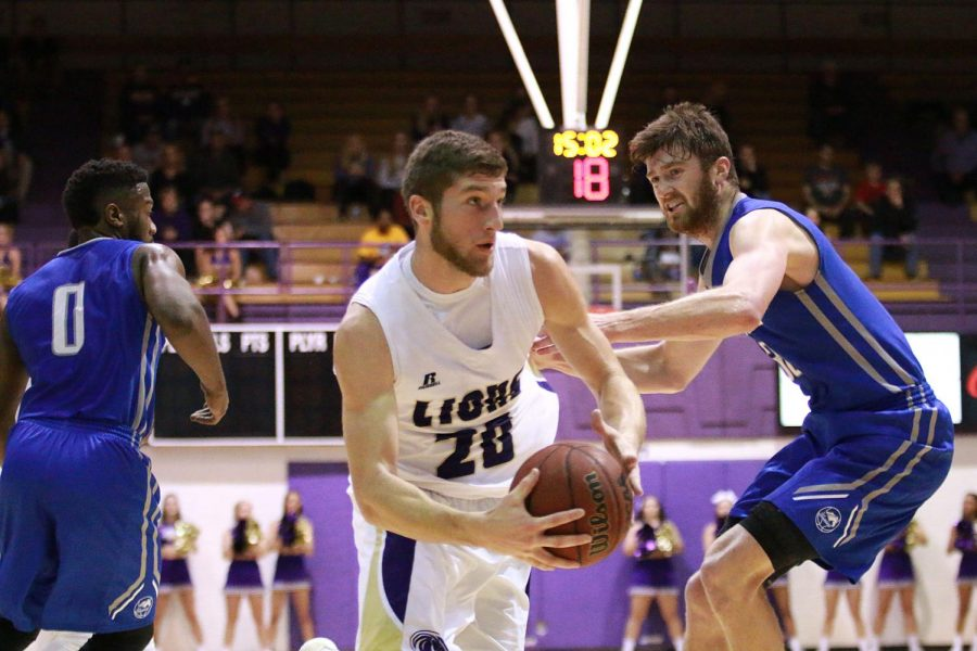 In their Dec. 4 home game versus Alabama-Huntsville, North Alabama forward Austin Timms drives to the basket for a layup attempt. UNA returned from their first Gulf South Conference road trip without a win, and look to get back in the win column Dec. 7 when they host Christian Brothers.