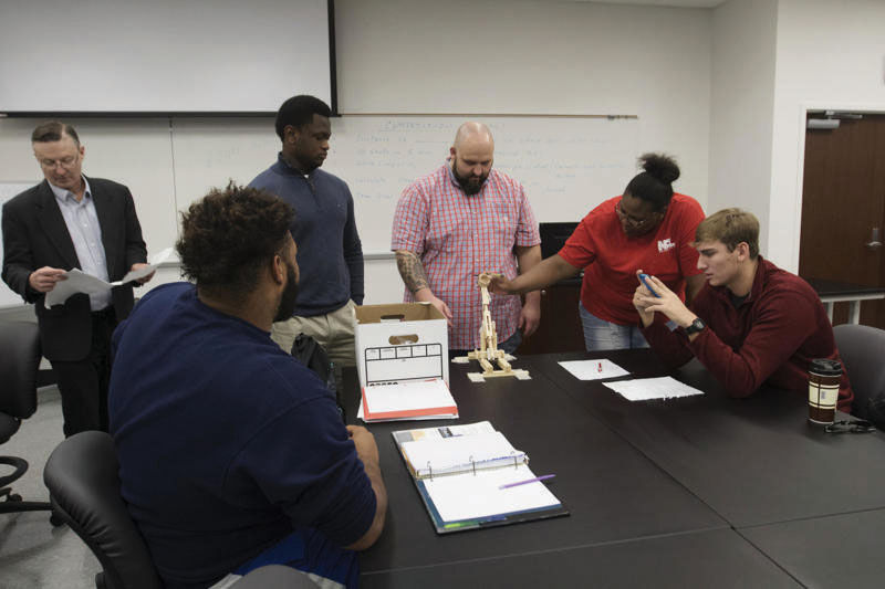 Engineering students learn math and science concepts for operating a catapult. The Department of Engineering Technology added more classes for students.