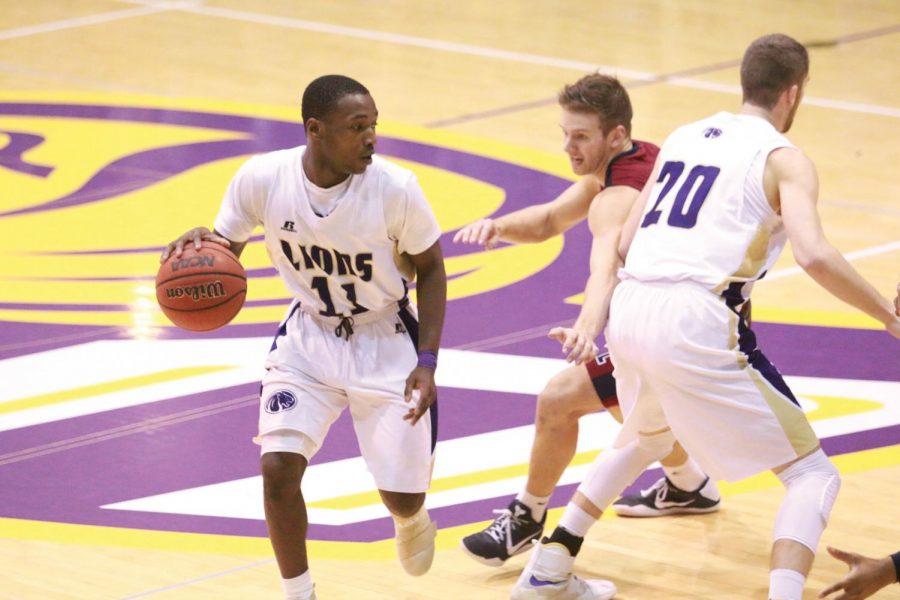 Senior guard Dimario Jackson tries to make a play off a screen versus Lee Jan. 19. Jackson leads the team in scoring thus far, averaging 15.9 points per game.