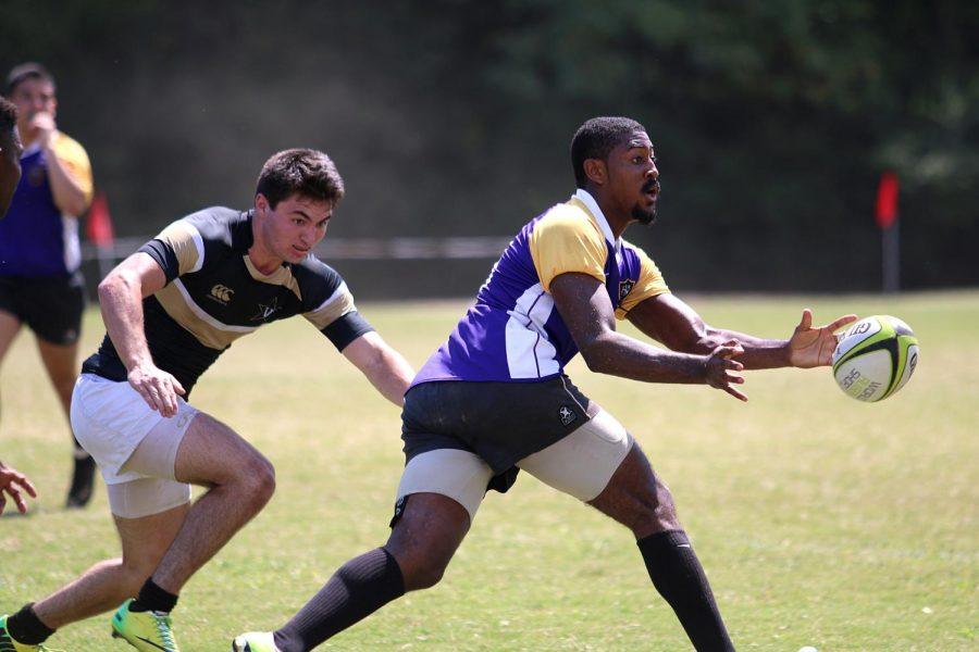 North Alabama rugby player Trevor Brooks pitches the ball back to a teammate in the Lions' season-opening victory against Vanderbilt at Veterans Park. The Lions went 6-1-1 during the fall portion of their season, and must win all three of their scheduled spring games to be eligible for playoffs