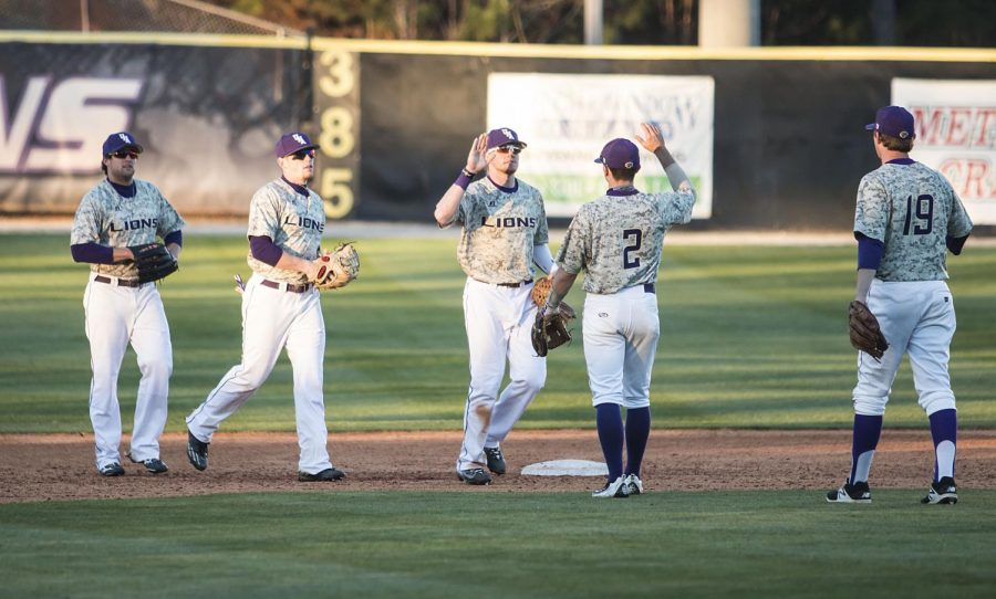 North+Alabama+baseball+players+congratulate+after+a+19-1+win+over+Lemoyne-Owen+Feb.+15+at+Mike+Lane+Field.+With+the+win+over+the+Magicians%2C+the+Lions+improve+to+4-3+headed+in+to+conference+play+at+West+Georgia+Feb.+18-19.