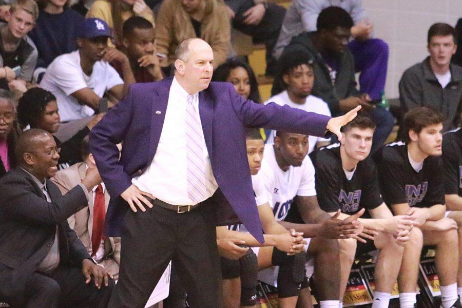 North Alabama men's basketball coach Bobby Champagne barks out orders to his team against West Florida Feb. 16 in Flowers Hall. Inspired by administrative assistant Peggy Wingo finishing her degree, Champagne began his quest for a master's degree in 2013, graduating in December 2016.