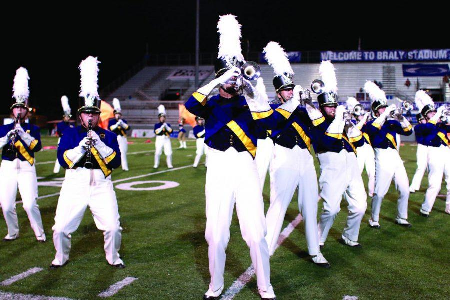 Band+members+perform+at+Braly+Stadium+at+the+2016+homecoming+game.+The+band+has+consistently+grown+under+the+lead+of+Lloyd+Jones%2C+Director+of+Bands.%C2%A0