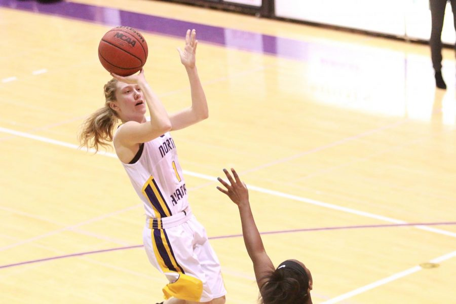 Freshman guard Emma Wallen shoots a jump shot against Valdosta State Feb. 18 at Flowers Hall. Wallen broke the school record for three-point field goals in a season with 73.