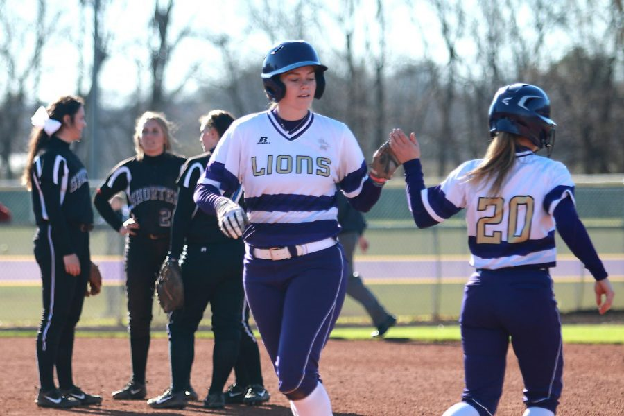 Junior+third+baseman+Shelby+Woodard+returns+to+the+dugout+in+North+Alabama%27s+Feb.+25+game+versus+Shorter+at+the+UNA+Softball+Complex.+The+Lions+swept+rival+West+Alabama+March+18-19+to+improve+to+9-6+in+Gulf+South+Conference+games+on+the+season.%C2%A0