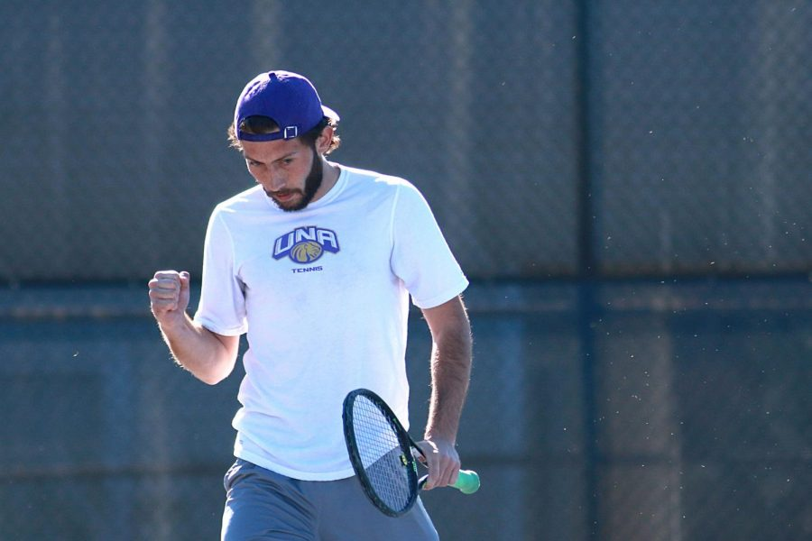 Graduate student Benji Poire celebrates a score against Martin Methodist at the UNA tennis complex Feb. 15. Poire and the UNA men's tennis team pulled an upset over the No. 16 Cameron Aggies with a 4-3 final in Florence March 11.
