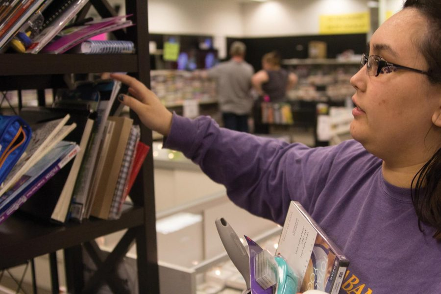 Graphic Designer Jackie Willis browses through books at Bargain Hunt. Readers voted the discount store the best bargain store in the Shoals.
