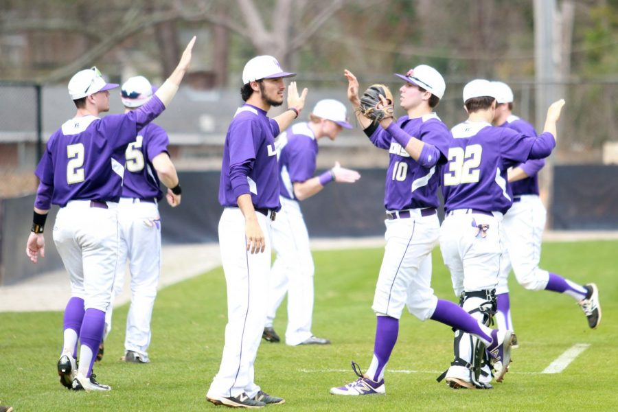UNA+baseball+players+celebrate+a+win+against+Bellarmine+Feb.+11+to+open+the+home+season+at+Mike+Lane+Field.+The+Lions+continued+its+winning+ways+entering+April+with+a+walk-off+celebration+Sunday+afternoon+with+an+8-7+victory+over+rival+Alabama-Huntsville.