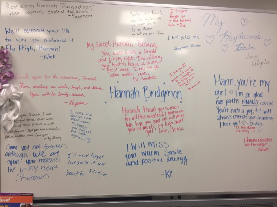 """The Communication Department put up a white board for students to write memories of Hannah Bridgmon on following her death May 5. One student wrote""""Radio is a family. We love, we live and we never forget."""""""