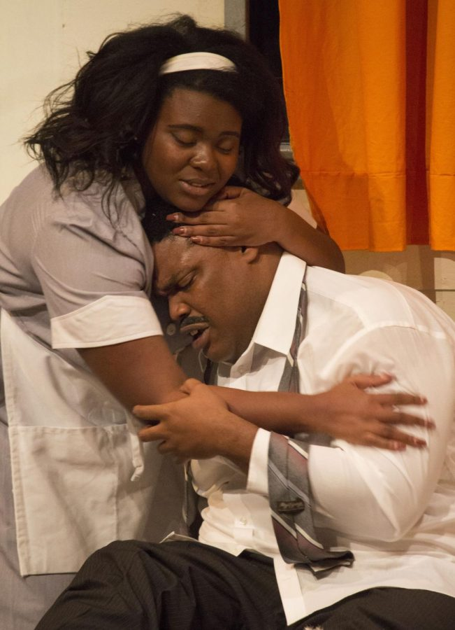 Camae (played by sophomore Destini Croom) calms Rev. Dr. Martin Luther King, Jr. (played by UNA theatre alumnus Michael Baldwin)as he comes to grips with his own mortality in a scene from UNA Summer Theatre's