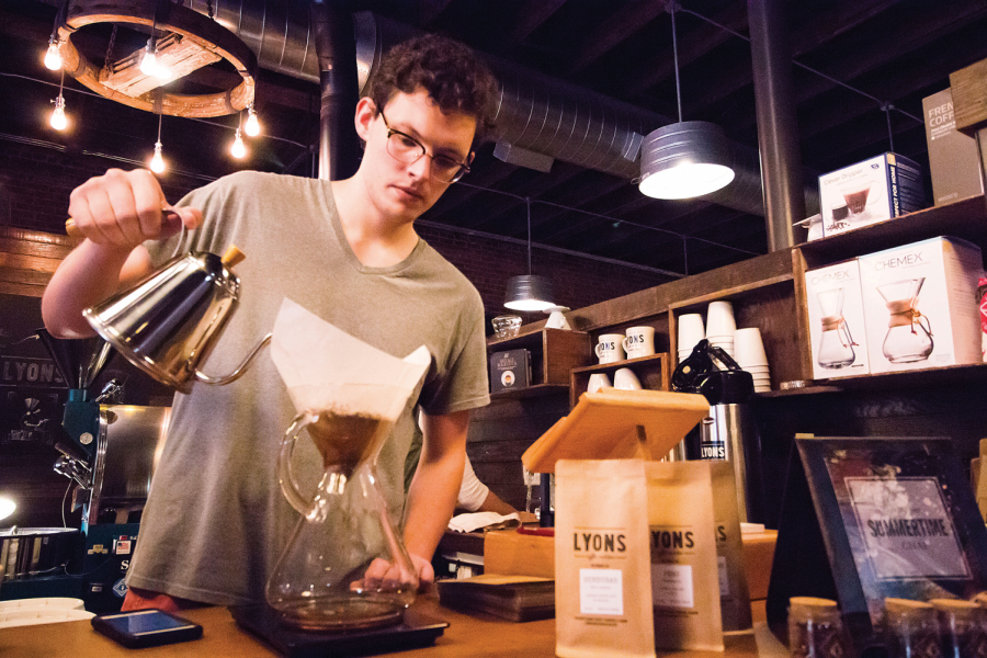 Employee+Ben+Schoenbachler+makes+coffee+at+Lyons+Coffee+Roasters.+The+roastery+is+in+Court+Street+Market.