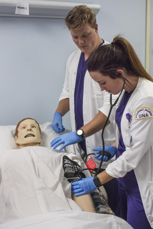 Senior nursing students Kara Shults and Garrett Grigsby work together on an in-class exercise. Alabama was ranked as 2017's fourth worst state for nurses despite the Anderson College of Nursing's recent testing achievements.