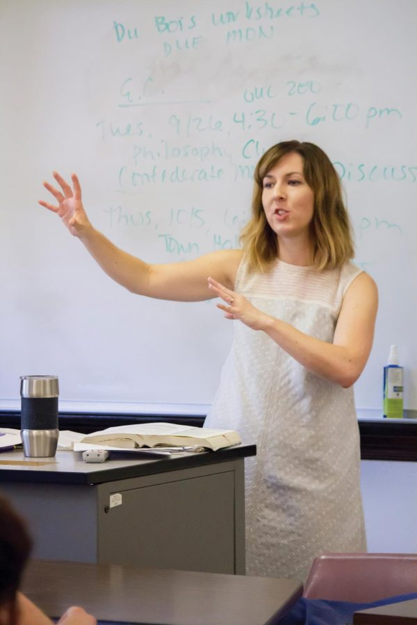 Assistant Professor of English Katie Owens-Murphy teaches a class in Bibb Graves Hall. Teaching is one of the many jobs she does for both the campus and community.