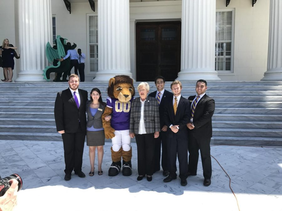 Sophomore+Chase+Holcombe%28left%29+stands+at+the+state+capitol+Aug.+24+with+Alabama+Governor+Kay+Ivey+and+various+other+Student+Government+Association+members+for+the+college+colors+day+proclamation.+Holcombe+is+currently+working+as+the+SGA+Chief+of+Staff+to+president+Hugo+Dante.