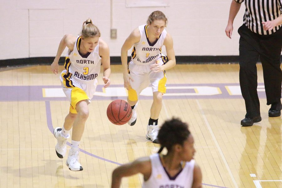 Sophomores+Ivy+and+Emma+Wallen+start+up+the+court+in+a+game+last+season.+The+Lions+have+started+3-0+this+season+while+scoring+100+points+in+the+season+opener.%C2%A0