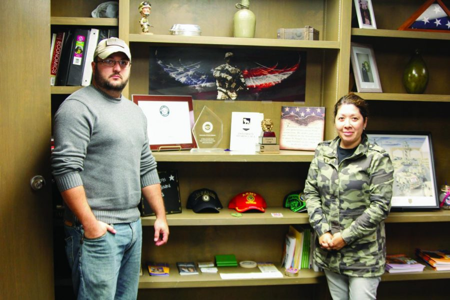 President of Veterans' Affairs Ryan Newton (left) and Michelle Daily, Veterans Affairs specialist, pose in front of their office's awards. In her two years at UNA, Dailey turned UNA into a military friendly university and added a dedicated space for veterans.
